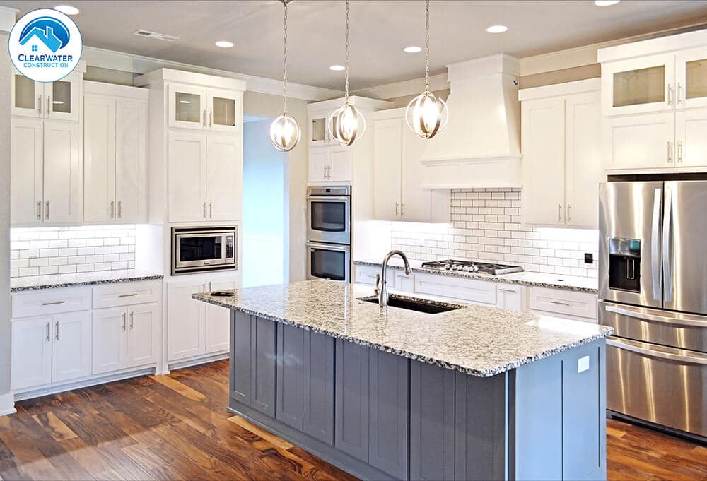 blue kitchen island home builder Northwest Arkansas